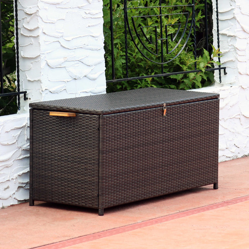 Outdoor deck storage box holding a variety of decor items.