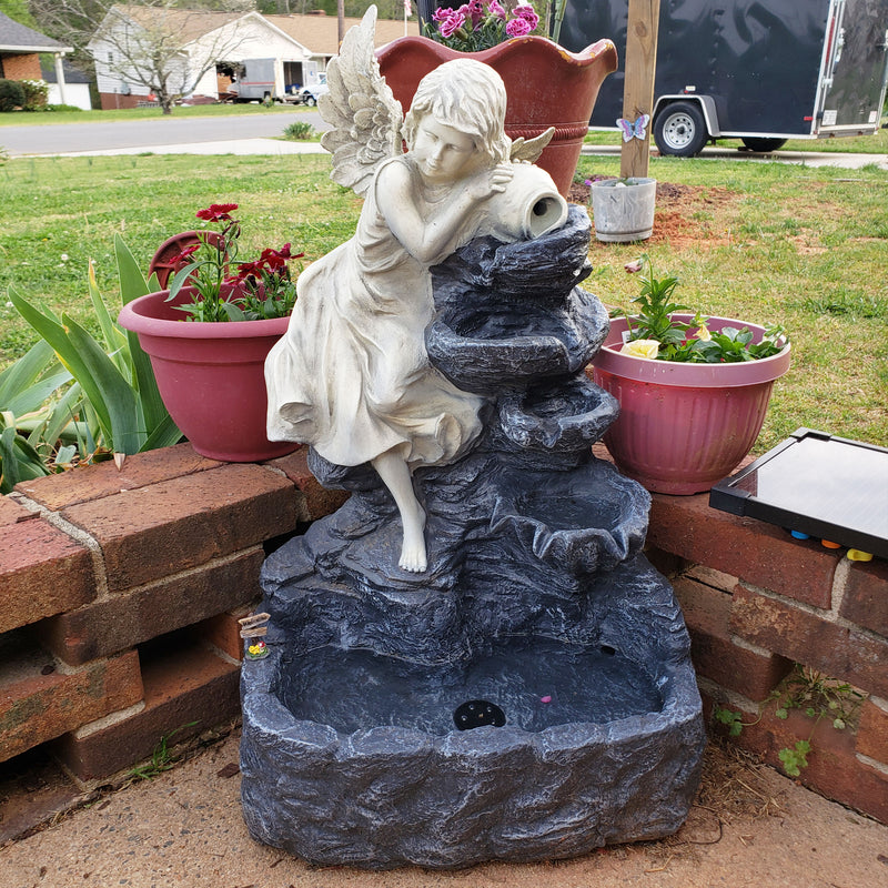Angel inspired solar powered water fountain on display on the front porch.