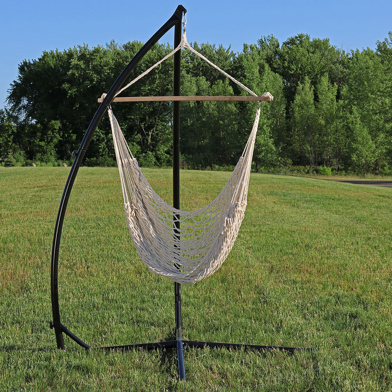 Cotton rope hammock chair with x-stand on display in the backyard,