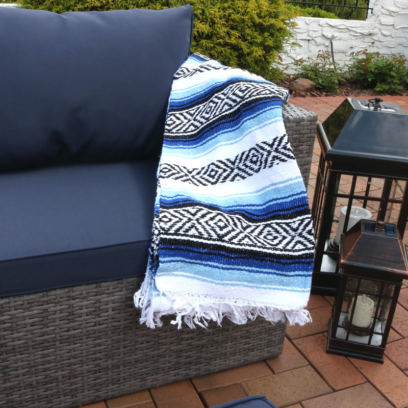 Mexican yoga beach blanket displayed outside on the patio.