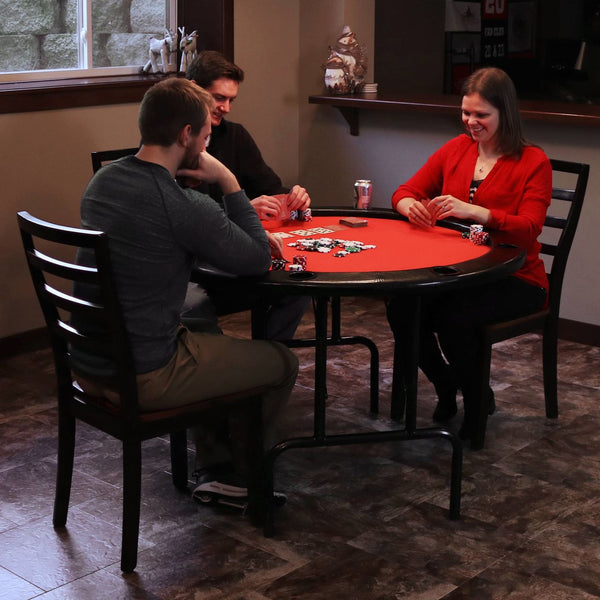Friends playing on a folding poker table.