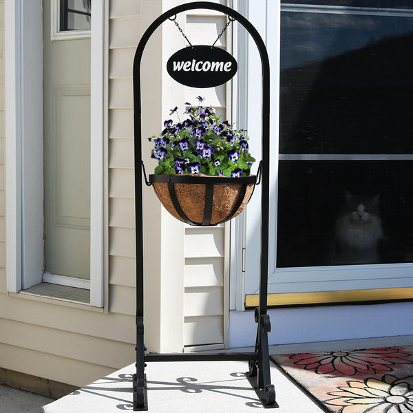 Welcome hanging basket plant stand placed on the front step.