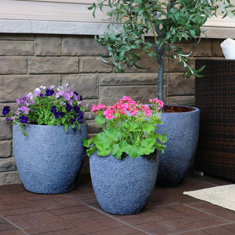 Set of 3 large outdoor flower pots displaying beautiful greenery.