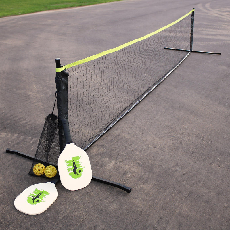 Portable pickleball net game set in a parking lot.