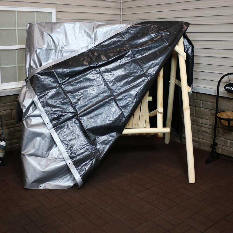 Heavy duty waterproof tarp covering a wooden patio swing.