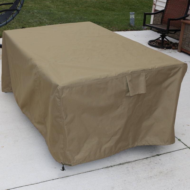 Outdoor patio table cover protecting a table.