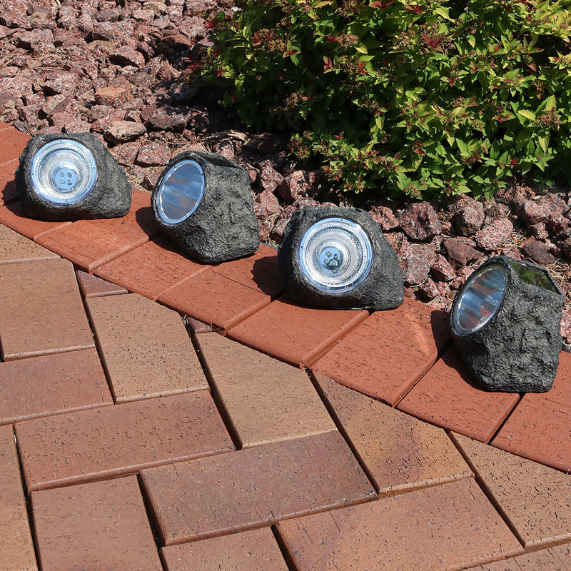 Outdoor rock LED solar spotlight displayed in the entryway.