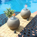 Outdoor tabletop citronella torch burning on a patio dining table.