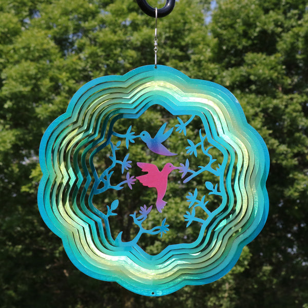 Hummingbird metal garden wind spinner hanging in the backyard.
