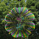 Dragonfly style metal garden wind spinner hanging in the yard.
