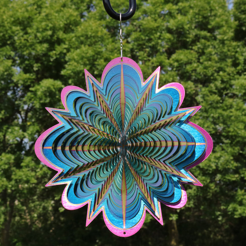 Blue dream metal garden wind spinner twirling in the yard.