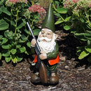 Unique hunting garden gnome displayed in the backyard.