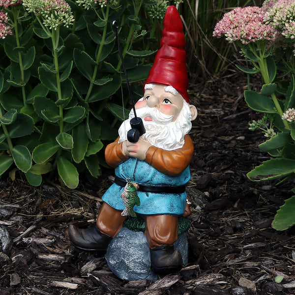 Unique fishing garden gnome displayed in the yard.
