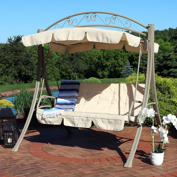 2 person patio swing with canopy displayed in the backyard.
