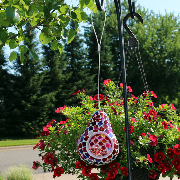 Pear-shaped mosaic bird feeder hanging from a shepherd hook.