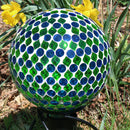 Mosaic gazing ball on display in the garden.
