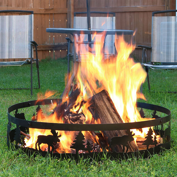 Moose inspired fire pit ring with a roaring fire in the backyard.