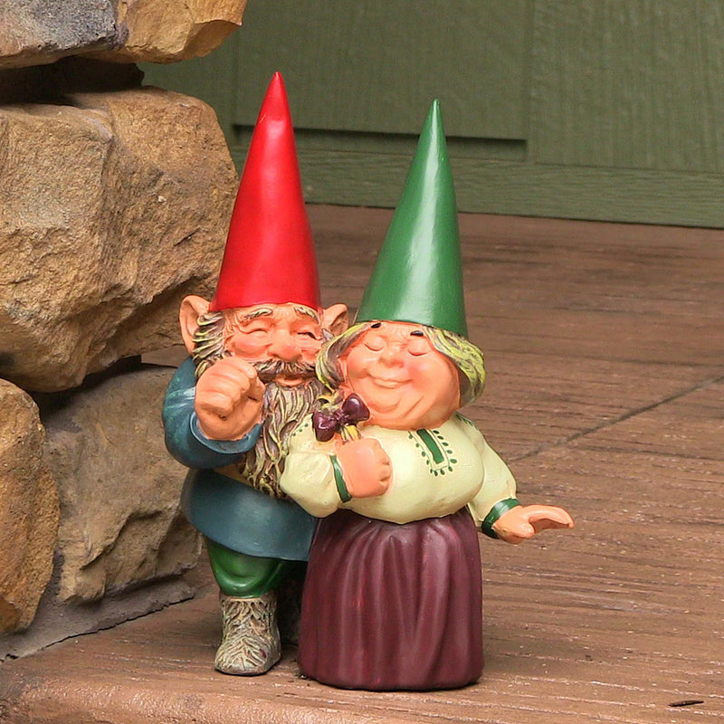 Classic garden gnome couple displayed on the front porch.