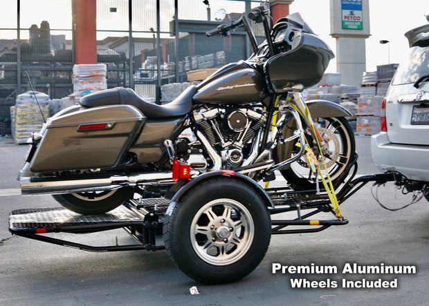 Ultra glide, honda goldwing, cruisers dirt bike and sport bike motorcycle trailer. Folds up for storage and stands out with the new wheels