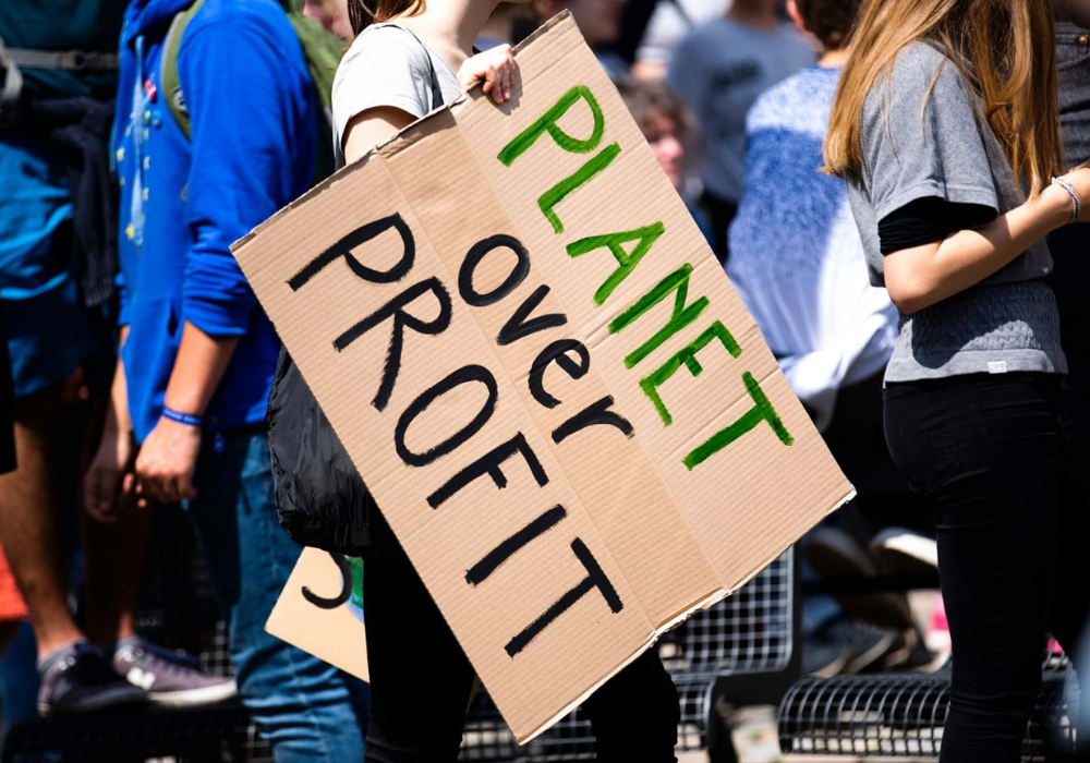 """Placard with the words """"Planet over profit"""""""