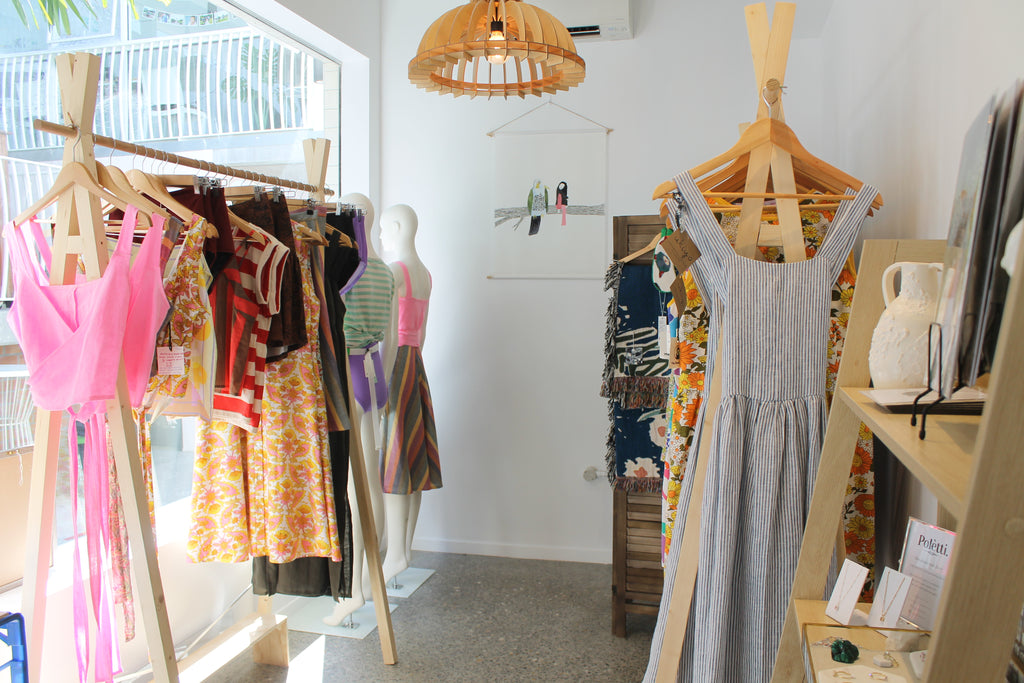 California Lane pop up shop interior with racks of clothing