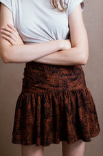 Tencel skirt with animal print in black and copper