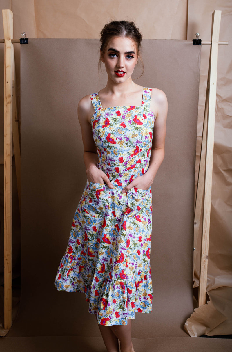 Model wearing ladylike floral midi dress