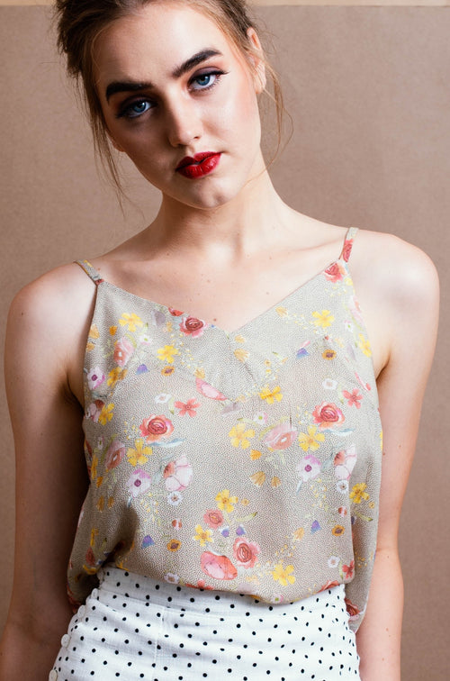 delicate camisole with floral print on beige spotty background