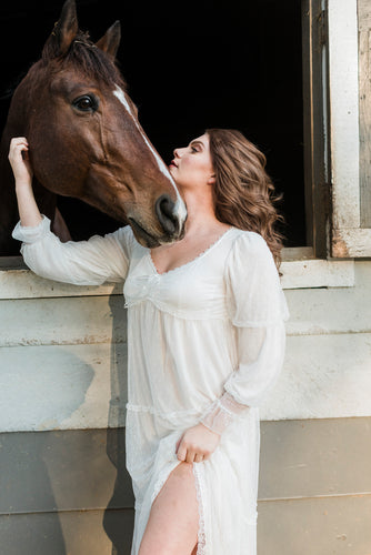 Image of a woman petting a horse wearing the Pretty Sheer Nightgown With Overlay from Margaret Lawton Nightgowns.