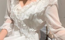 Close up detail of ruffles on elegant chiffon robe.