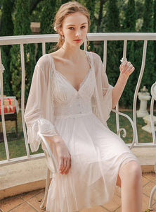Margaret Lawton Nightgowns beautiful chiffon set includes an elegant robe and thigh-length gown. With gracefully layered chemise featuring lace, buttons, and a stunning bow, this set is sure to make a lasting impression.