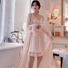 Beautiful lace trimmed nightgown with long ruffle trimmed chiffon robe.