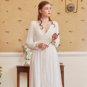 Pretty long sleeve nightgown with V-neck and lacce cuffs. Empire lace waist with three pearl buttons.  The top chiffon layer has a split to the waist and underlay splits to just above the knee.