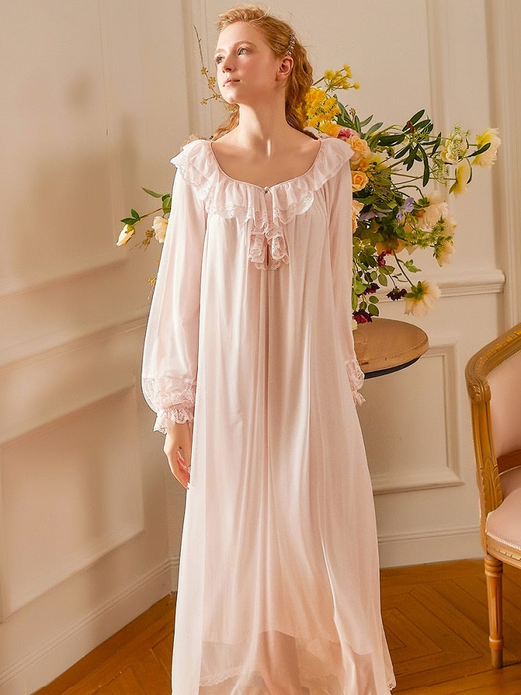 Image of a woman wearing a pink Classic Nightgown from Margaret Lawton Nightgowns.