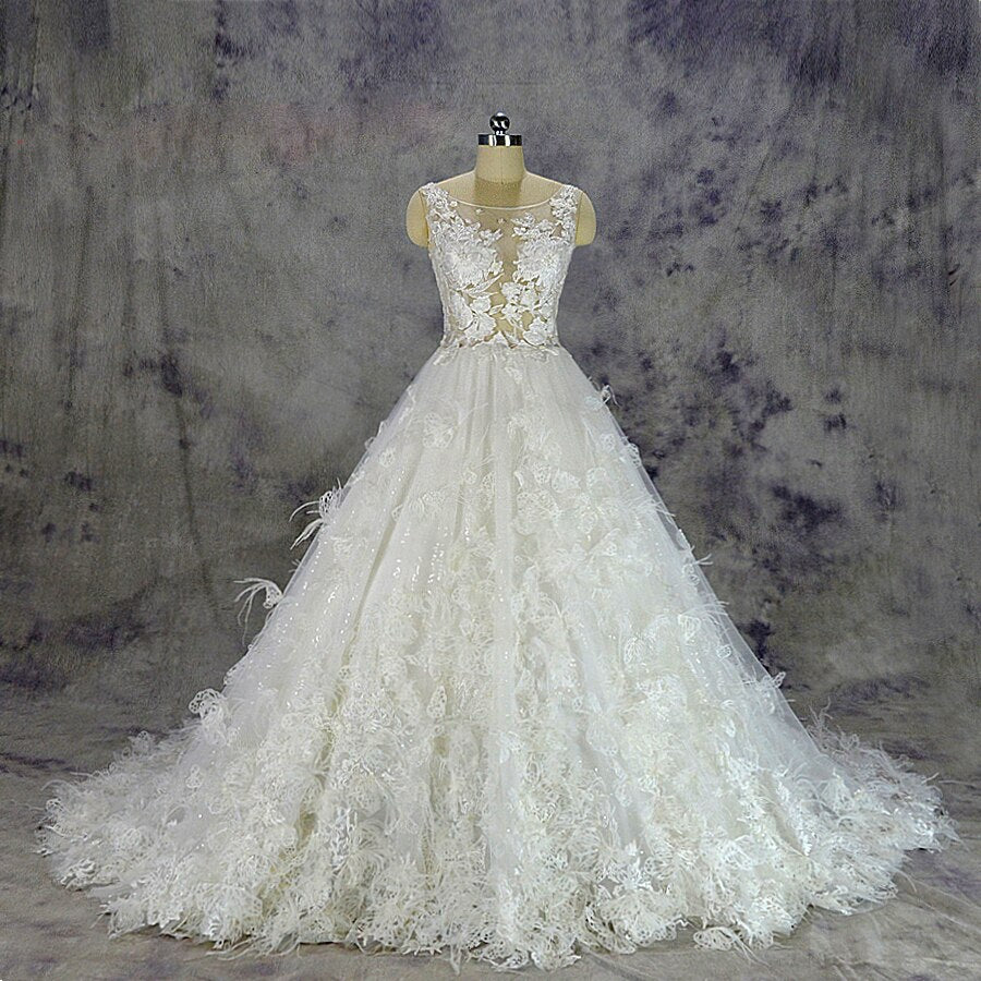 2019 Luxurious Feather Wedding Dress sexy transparent top Bridal gown custom made ball gown skirt with flowers and feathers