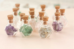 healing gemstone crystals in bottles