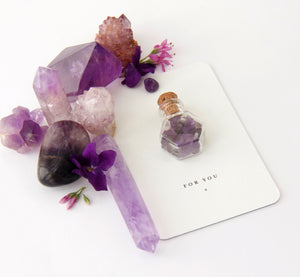 amethyst crystals in bottle on gift card