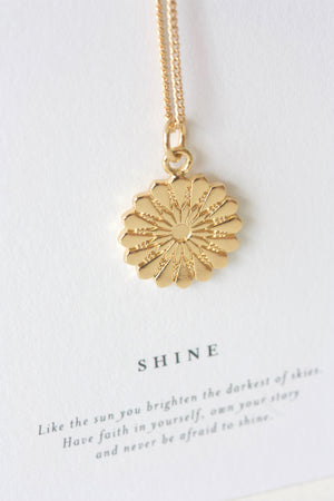Gold sunshine necklace with positive quote