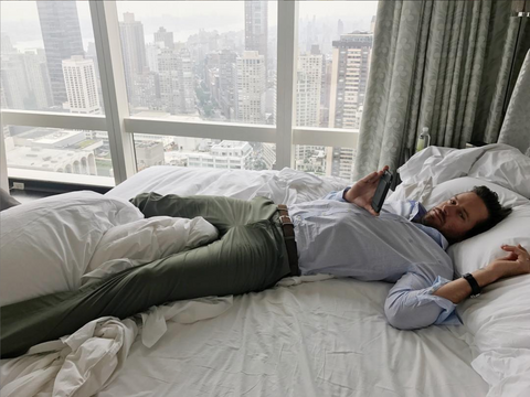 Armie Hammer on bed