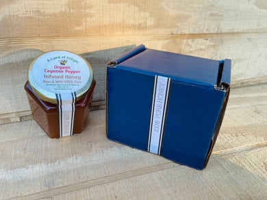 Specialty Gourmet Honey: Organic Cayenne Infused Raw Honey - 12oz Jar Next to Blue Gift Box