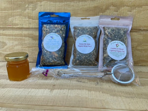 Candida & Fibroid Fighting Organic Tea Gift Set with Tea Ball, and Honey on Wooden Counter Top