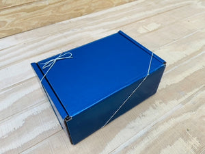 Angled Picture of Blue Gift Box for Gourmet Organic Medium-Dark Roast Whole Bean Coffee Beans