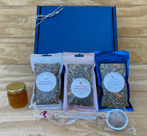 Candida & Fibroid Fighting Organic Tea Gift Set with Gift Box, Tea Ball, and Honey  on Wooden Counter Top