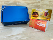 Load image into Gallery viewer, Bio Coffee & Cocoringa Moringa Gift Set sitting next to a gift box on wooden countertop