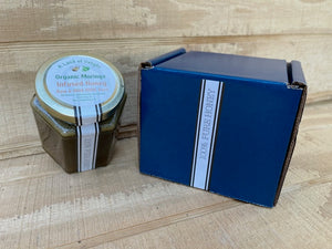 Specialty Gourmet Honey: Organic Moringa Infused Raw Honey - 12oz Jar Next To Blue Gift Box