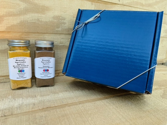 Organic Spice Blends on Counter Next to Blue Gift Box