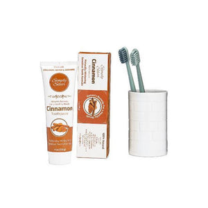 Simply Silver Toothpaste - Cinnamon Flavor Next to Cup with Two Toothbrushes