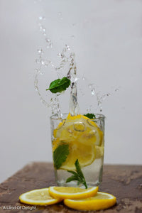 Bearss Lemon slices dropped into glass of water