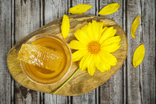 Load image into Gallery viewer, Cutting Board with honey and honeycomb in glass bowl sitting on wooden cutting board with wildflower laying beside it