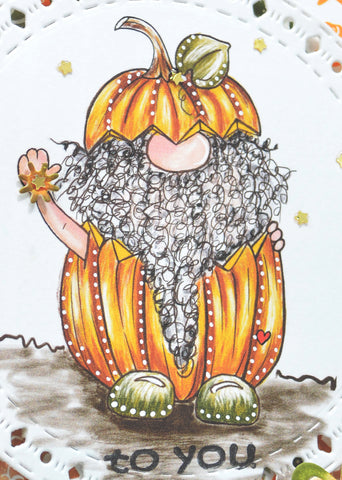 It's Jack O'Gnome free digital stamp image in all his glory closeup and friendly in his pumpking costume ready to hand you his flower.  To You.  decorated with spots and dots, he's perfect for any Halloween greeting card